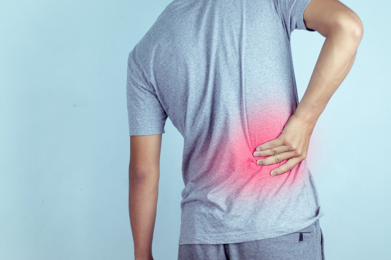 man suffering from backache,Lower back pain